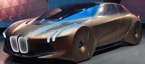 """2021年的宝马iNEXT将是一款采用双电动机驱动的高档SUV,车内装有巨大的信息娱乐屏幕,就像特斯拉Model X一样。因此,基于其他可能的替代品,例如Jaguar I-Pace,您可以期望这辆车的起价约为65,000英镑。    2021 BMW iNEXT信息娱乐和内饰 2021年宝马iNEXT上的最新消息以新图像的形式出现,这暗示了将安装在SUV上的信息娱乐屏幕。大型弧形显示屏将通过触摸操作进行操作,并占据汽车仪表板的绝大部分。它的横向布局与特斯拉Model X所安装的巨大的肖像式屏幕形成鲜明对比。但是,像特斯拉一样,宝马的屏幕将成为汽车内部操作功能的主要方式,它将取代您通常会找到的许多按钮和转盘。  当前的宝马信息娱乐系统的直观性和位置受到赞誉,向驾驶员倾斜。这使得它们更容易到达而不会不必要地分散注意力。凭借其凹入的形状和巨大的尺寸,您可以期望这些优点在iNEXT的触摸屏中得到放大。  2021 BMW iNEXT是一款大型SUV,大小与BMW X5相同。因此,您可以期待一个可以愉快地容纳四个全尺寸成年人的内饰,并且行李箱足够宽敞,可以容纳两周的行李。  2021年宝马iNEXT背后的最初概念– Vision iNEXT –提出了汽车内饰具有两种""""模式""""的想法。其中第一个是Boost,它将信息娱乐屏幕和方向盘清晰而牢固地定位在驾驶员的前方。第二个是"""" Ease"""",它使方向盘缩回并围绕自动驾驶创造了一个更加放松的环境。2021年iNEXT真正投入生产时是否会出现这种情况尚待观察。   BMW Vision iNEXT概念车的设计 2021 BMW iNEXT造型 在宝马的许多最新车型中,例如7系和X7,该品牌都通过使前大灯更纤细和格栅更大而重新设计了汽车的前端。BMW Vision iNEXT概念车的图像显示,这种新型SUV将继续保持这一趋势。它结合了制造商签名的""""肾脏""""格栅的巨大连体变体,以及缝隙一样细的LED大灯。两侧的一对直角,近乎夸张的进气口补充了格栅的大型,四方形的外观。  可悲的是,由于这些是概念性图像,这些选择可能会在2021年宝马iNEXT实际投入生产时改变。最近用厚重迷彩包裹的模型照片暗示其巨大的格栅仍将保留。但是,灯光看起来不像概念车那么大。   据其制造商称,2021年宝马iNEXT将提供""""高度自动驾驶""""。如果汽车希望采用特斯拉Model X令人难以置信的高科技功能,那么它将必须具有自动行车道变更功能,自适应巡航控制和路标读取技术。  2021年宝马iNEXT将采用再生制动。这将激活您将脚从加速器上移开的那一刻,从而有助于从制动器中收集原本浪费的能量,然后将这些能量用于补充电池。  2021 BMW iNEXT将由双电动机驱动-每对车轮一个。这将使汽车成为四轮驱动。由于没有变速箱或机械差速器-正如您在当前的四轮驱动SUV(例如BMW X5)中所获得的-iNEXT能够对不断变化的地形做出快速反应,立即向最抓握的车轮发送动力。这也意味着,iNEXT实际上将能够像两辆不同的汽车一样行驶。它会在想要的时候像跑车一样在角落滑动,或者在您不想要时会感觉安全,牢固且易于驾驶。"""